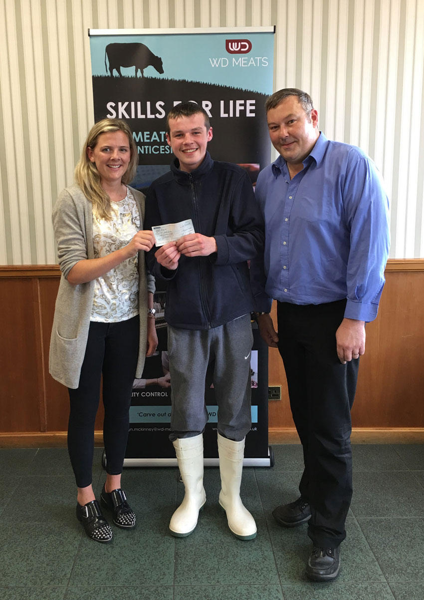 Cheque presentation for successful completion of NVQ Level 2, by Clare Holly (Marketing Manager) and Sam Murphy (Training Manager) to Scott McLaughlin (Apprentice Butcher).